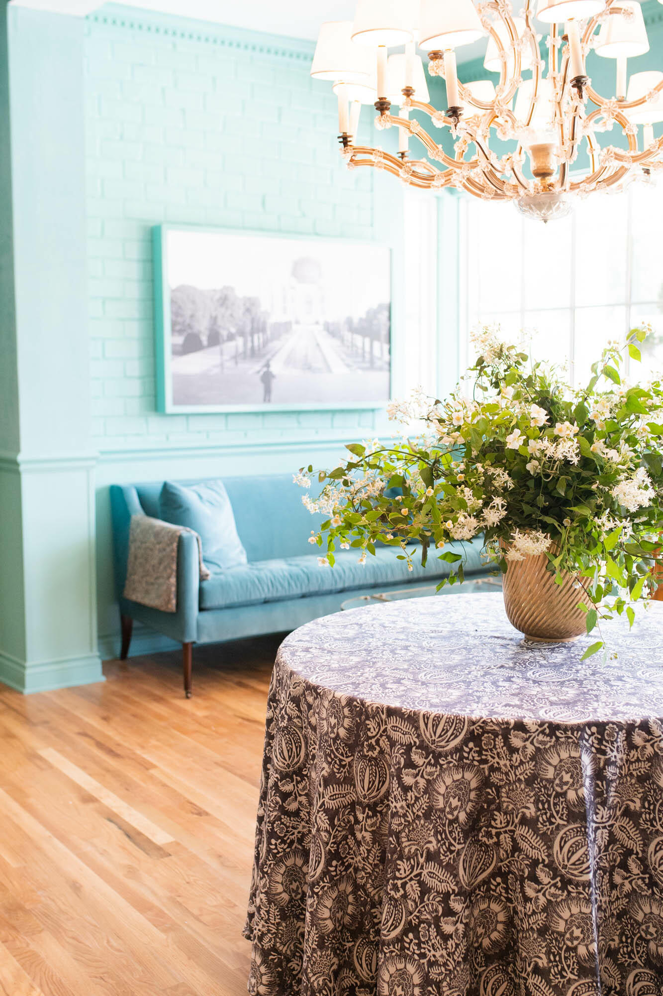 table and plant in spacious room with blue walls