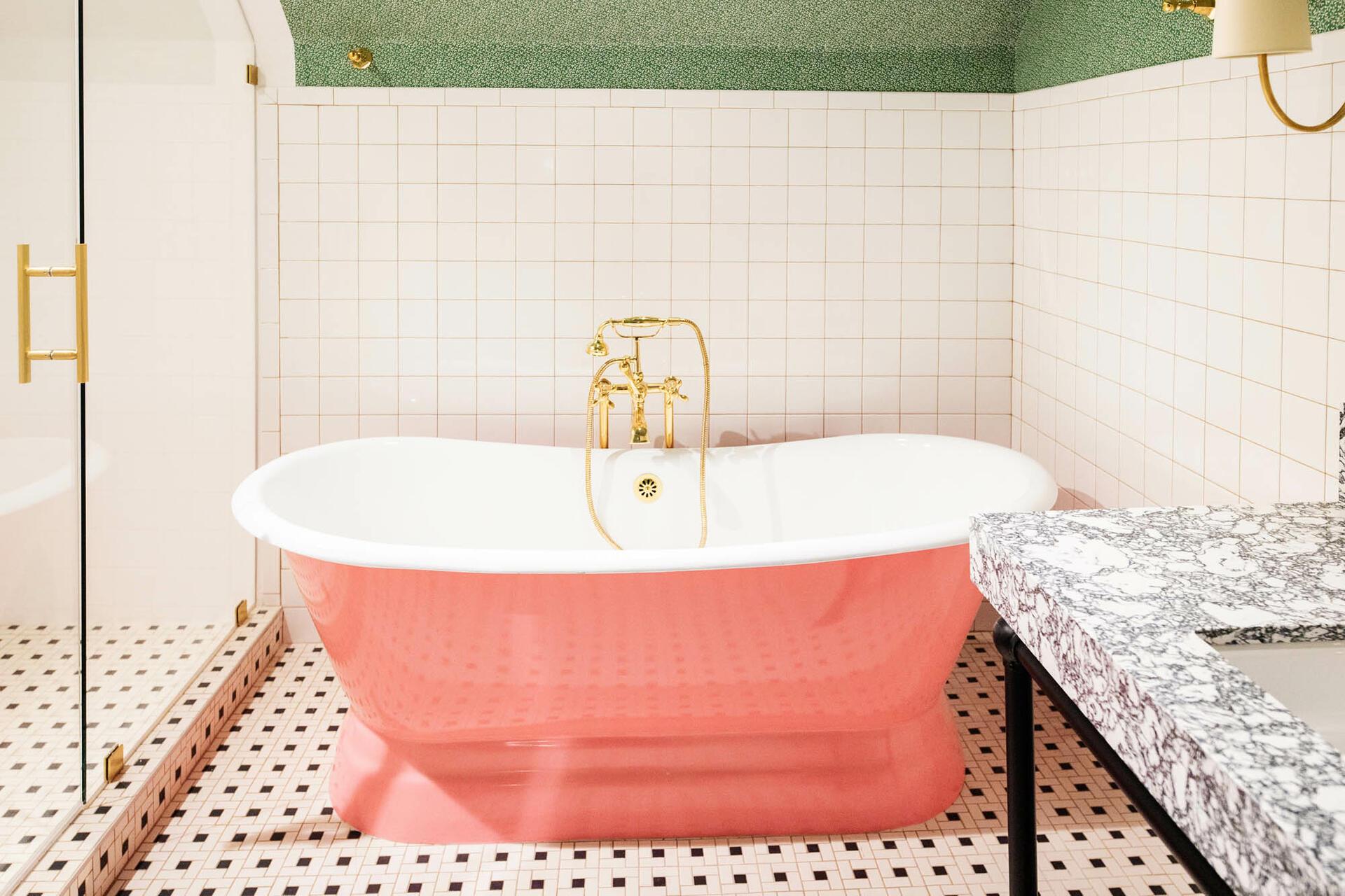 pink bathtub in boutique bathroom