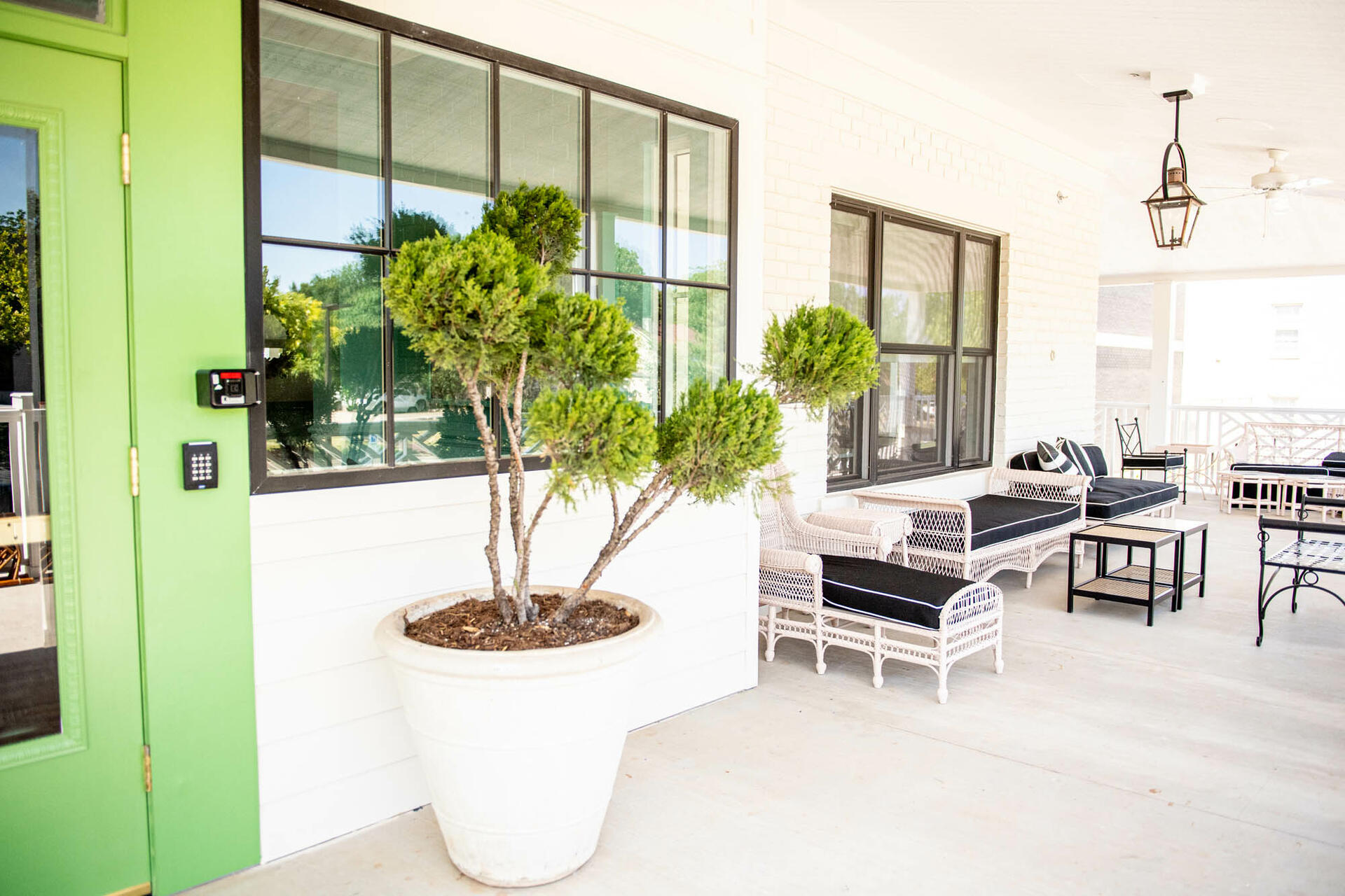 outdoor patio with chairs and plants