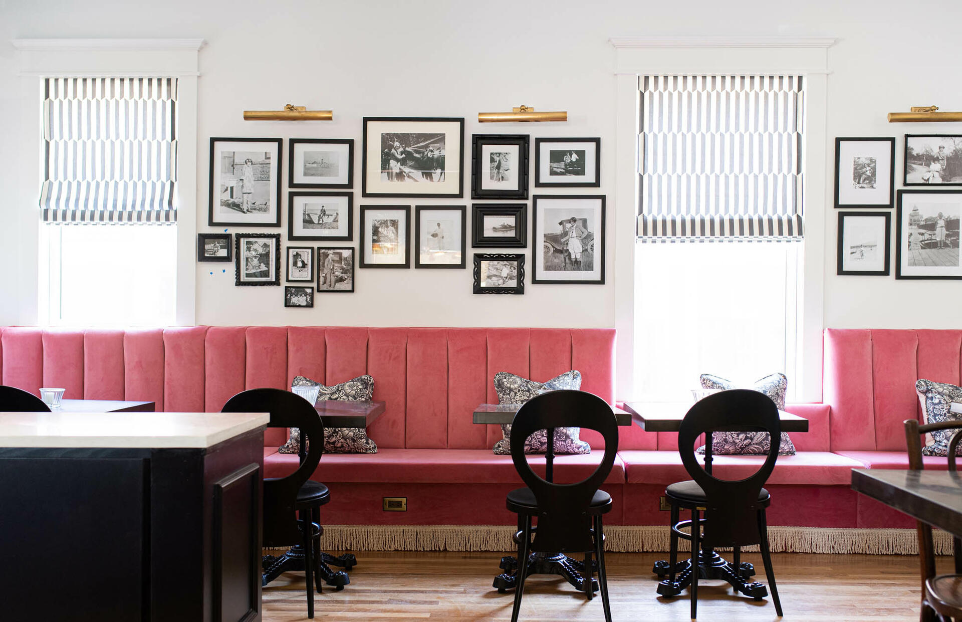 room with pink chairs and wall art
