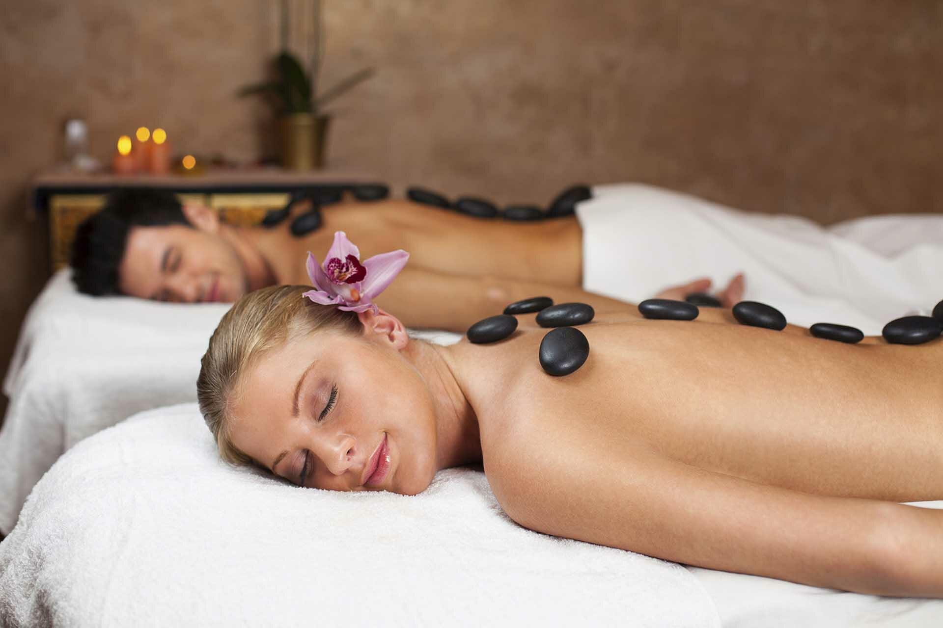 Couple getting a hot stone massage in a spa, Daytona Beach, Ocea