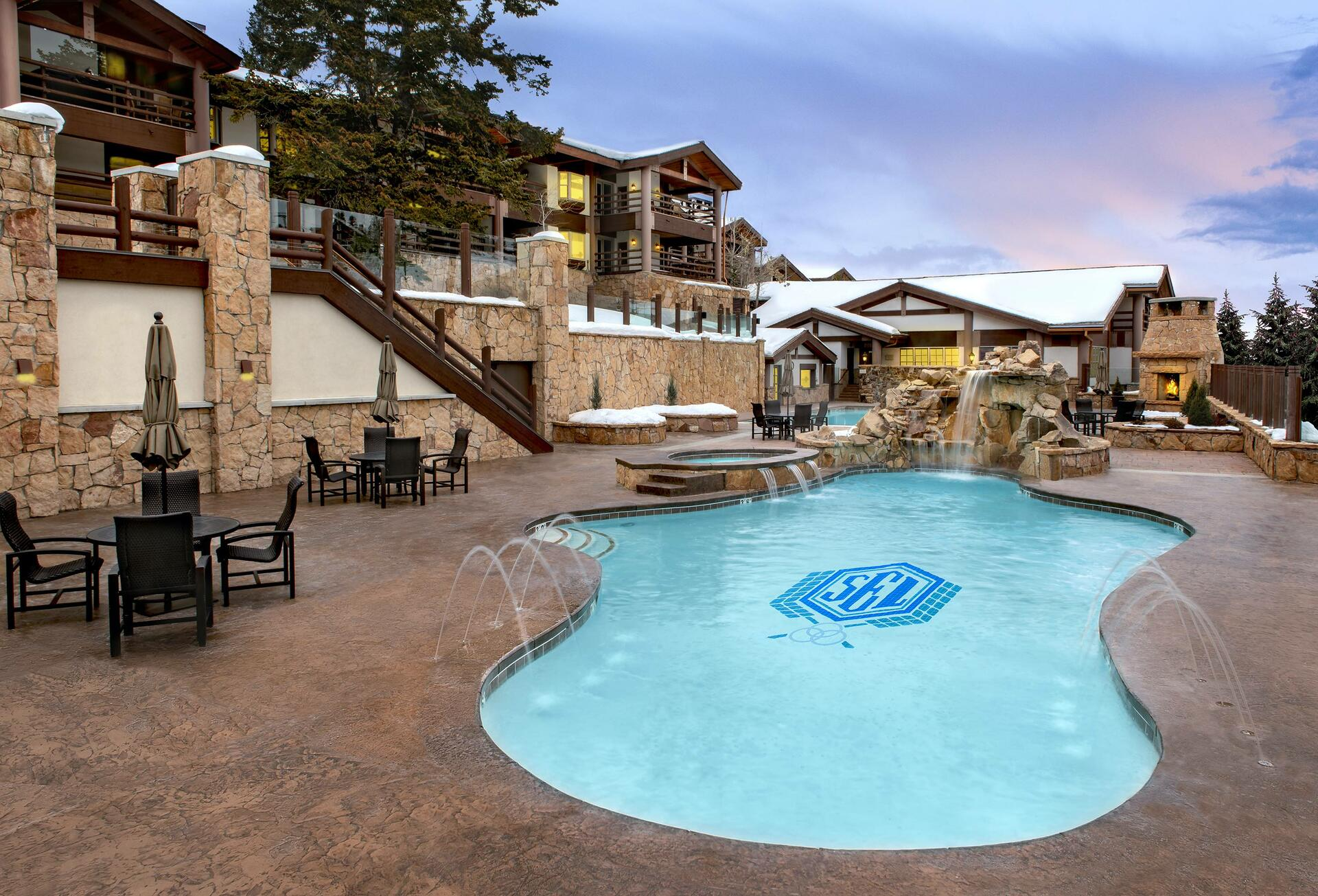 a pool in front of a lodge
