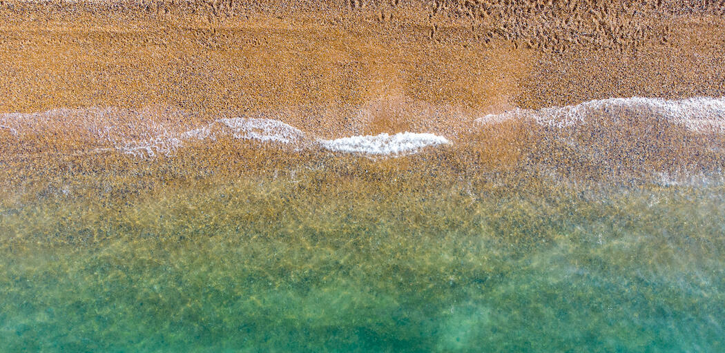 Brighton beach tide, sea and sand from above