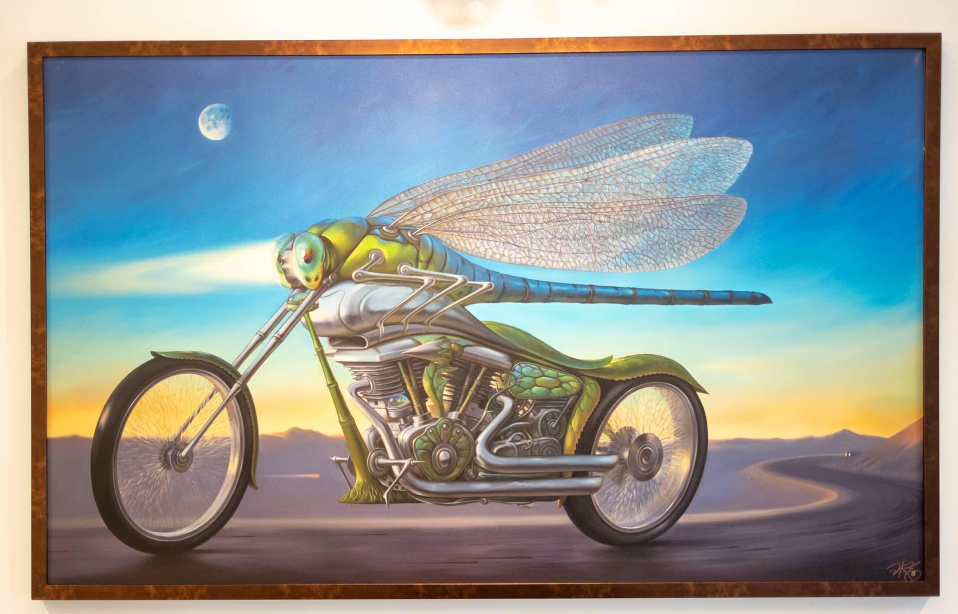 painting of a bug riding a motor cycle