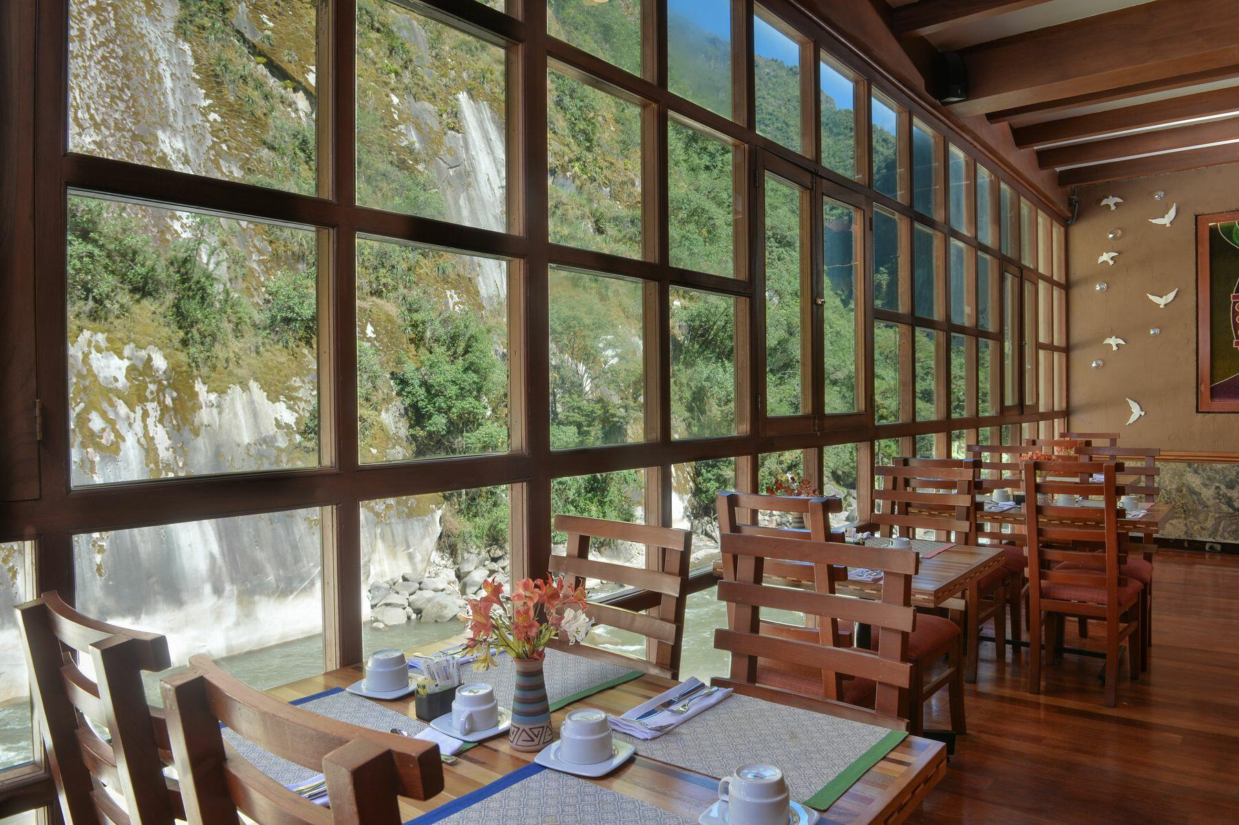 restaurant dining room with tables, chairs and river view