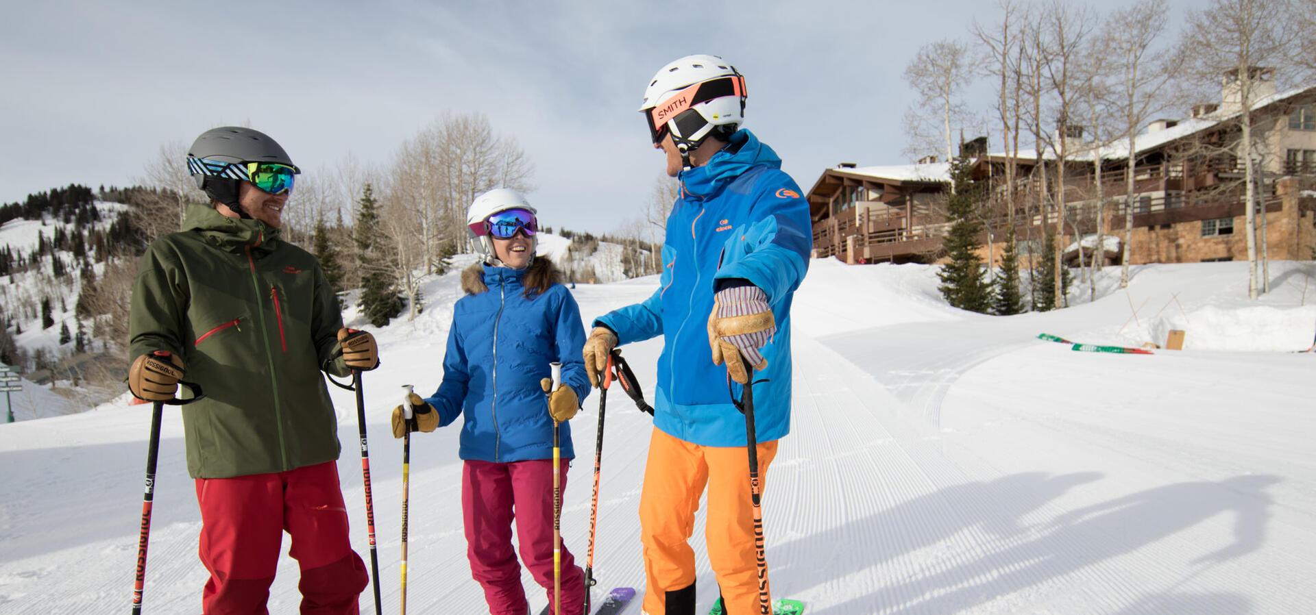 three people on skis