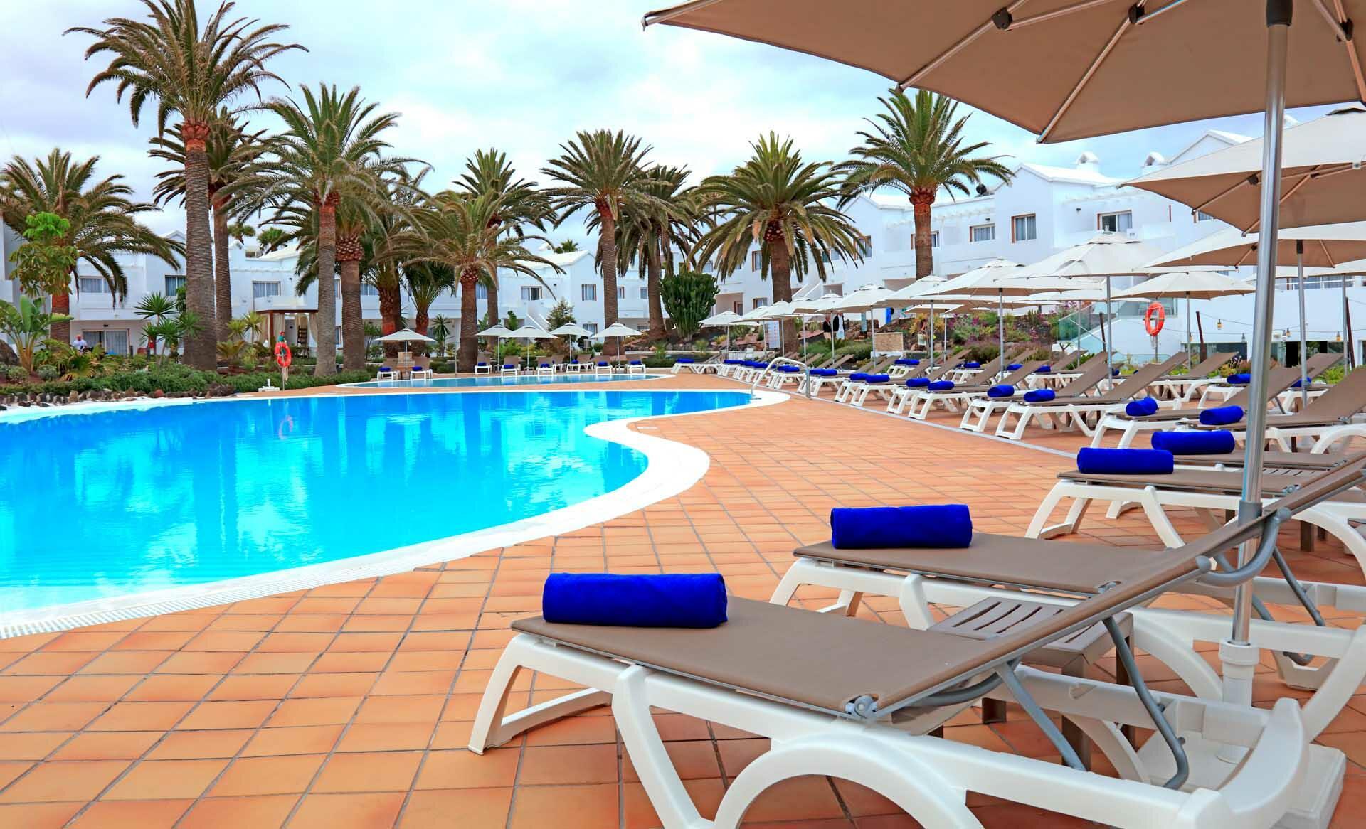 Deckchairs And Umbrellas At The Main Pool At Labranda Corralejo