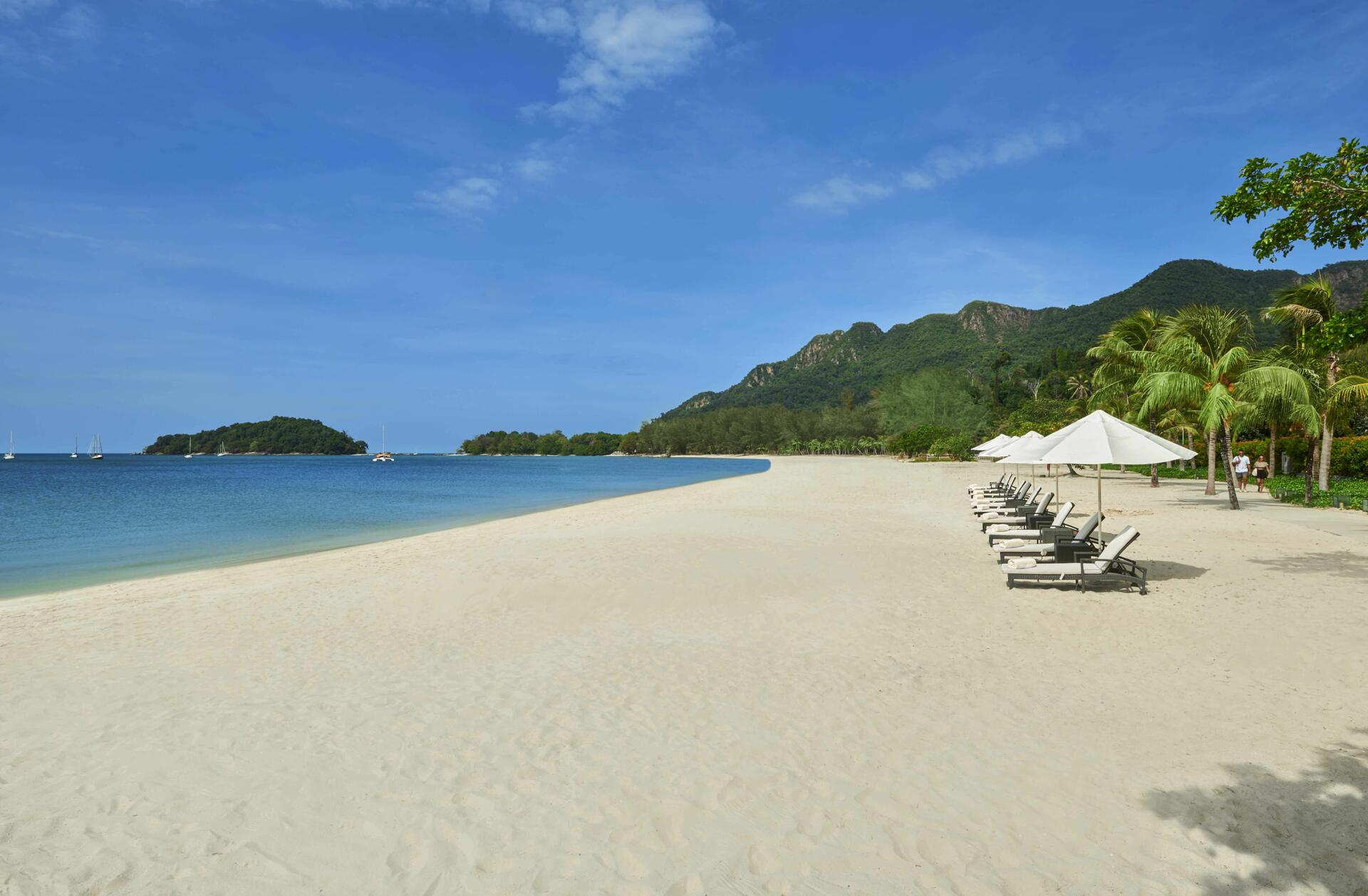 Beach by The Danna Langkawi with sunbeds