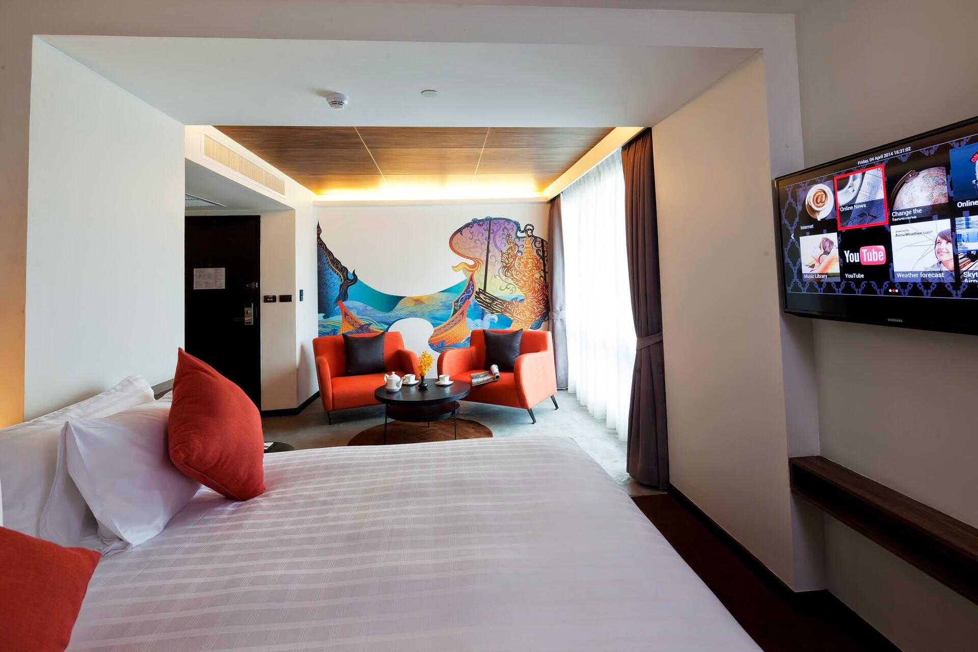 Hotel Bedroom with sitting area, television and a decorative wal