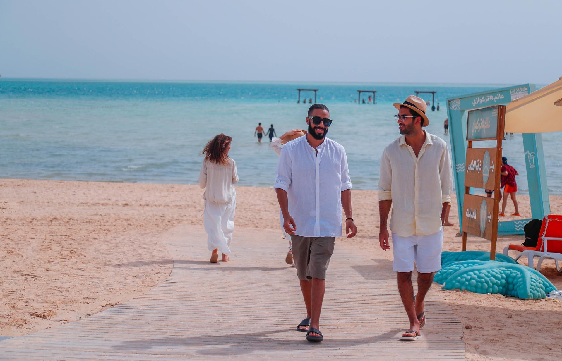 People by the beach near Bay La Sun Hotel & Marina