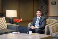 Coast Canmore Hotel & Conference Centre - Business Man in Lobby(1)