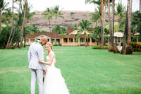 Wedding photo on the great lawn located at Waimea Plantation Cottages