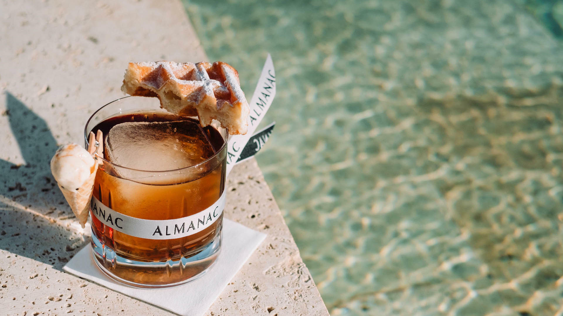 Azimuth Rooftop Bar Cocktail with a Waffle at Almanac Group