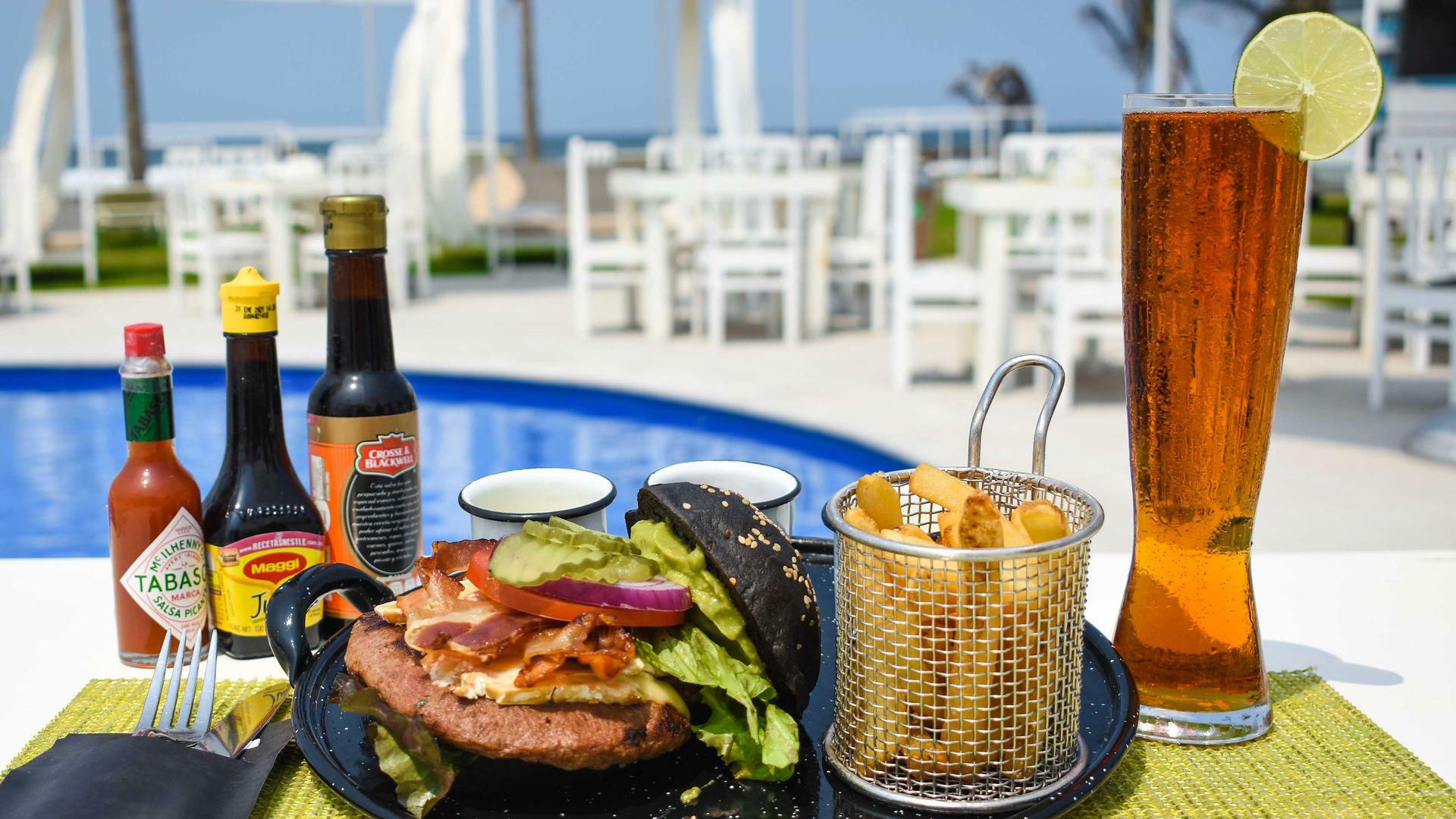 Burger dish served at Scala Ocean Club at Mundo Imperial