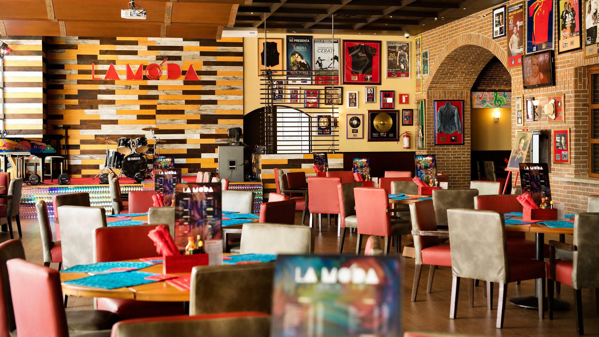 Dining area at La Moda Restaurant in Mundo Imperial