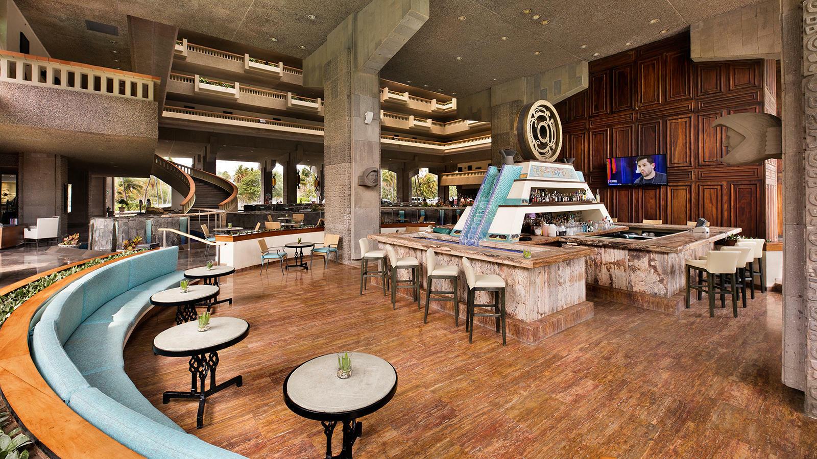 Indoor seating area at Laguna Bar in Mundo Imperial