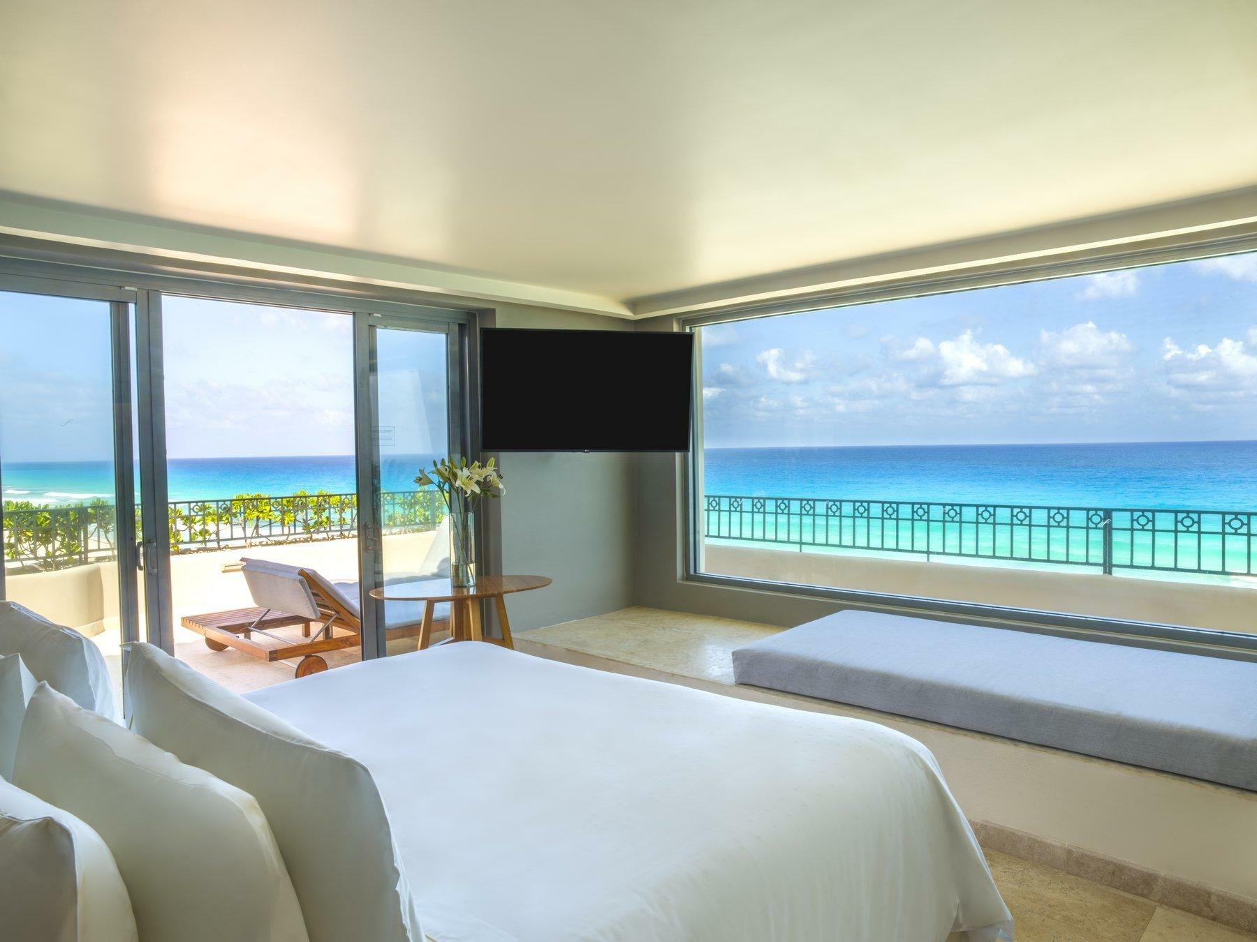 room with king bed and ocean view