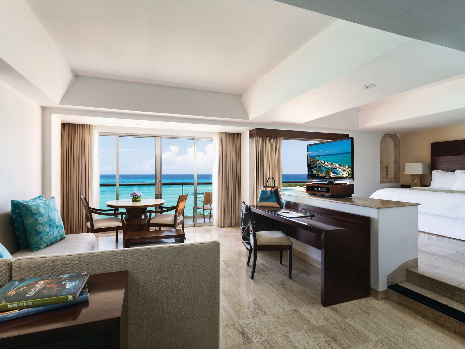open living room and bedroom with ocean view