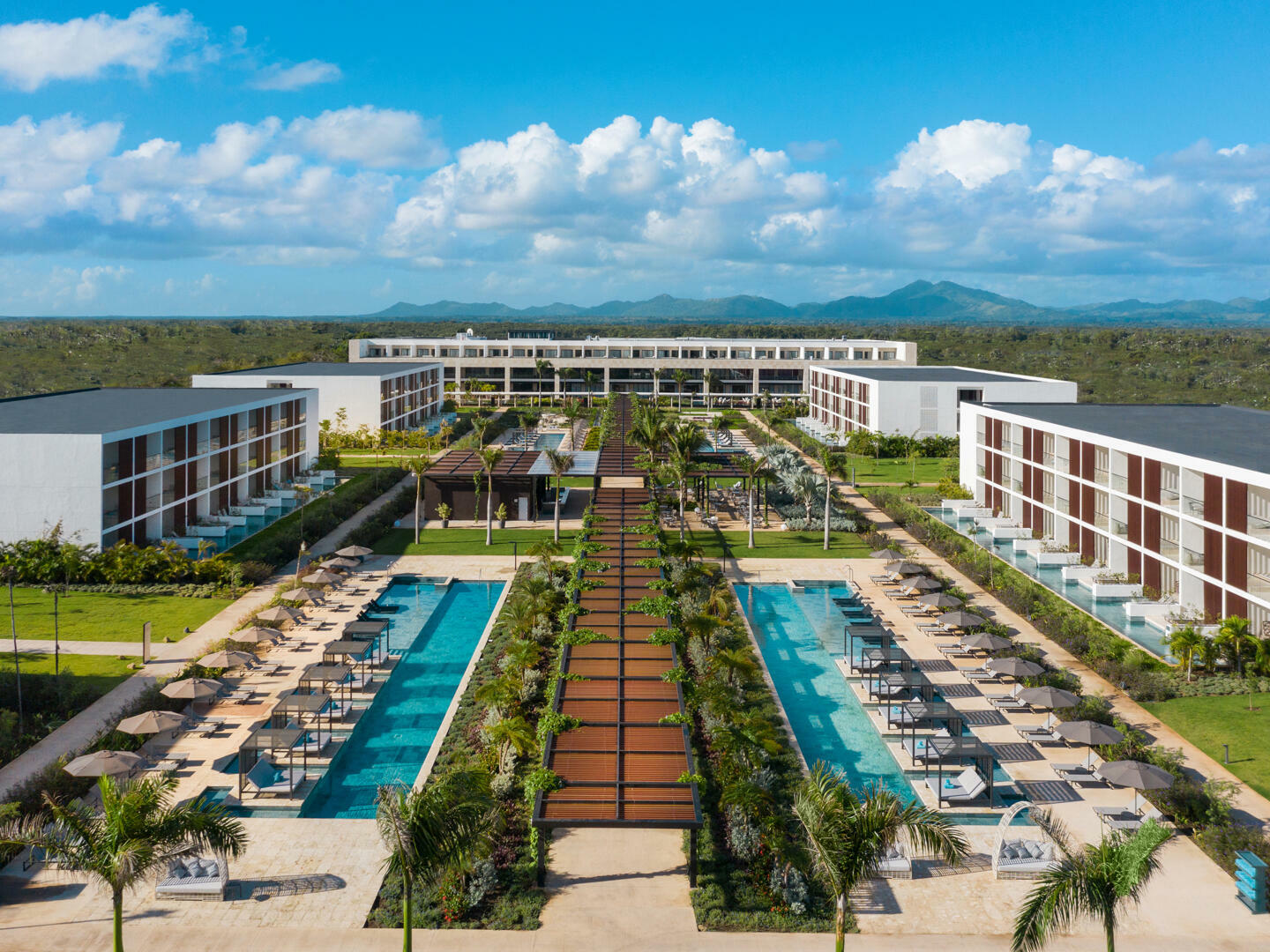 Exterior view a hotel with pool in the Punta Cana city