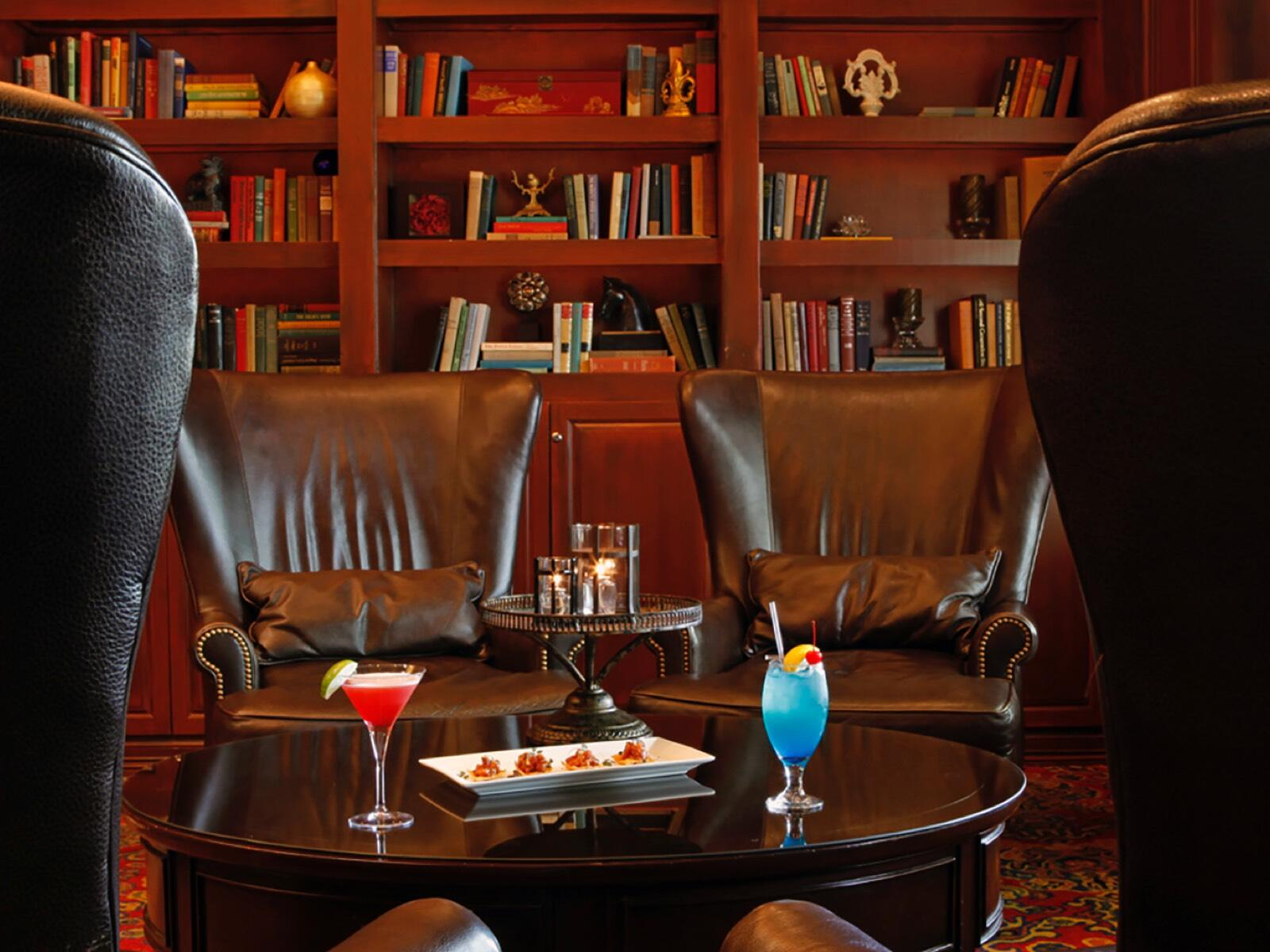 Wingback Chairs Library Bar with Drinks