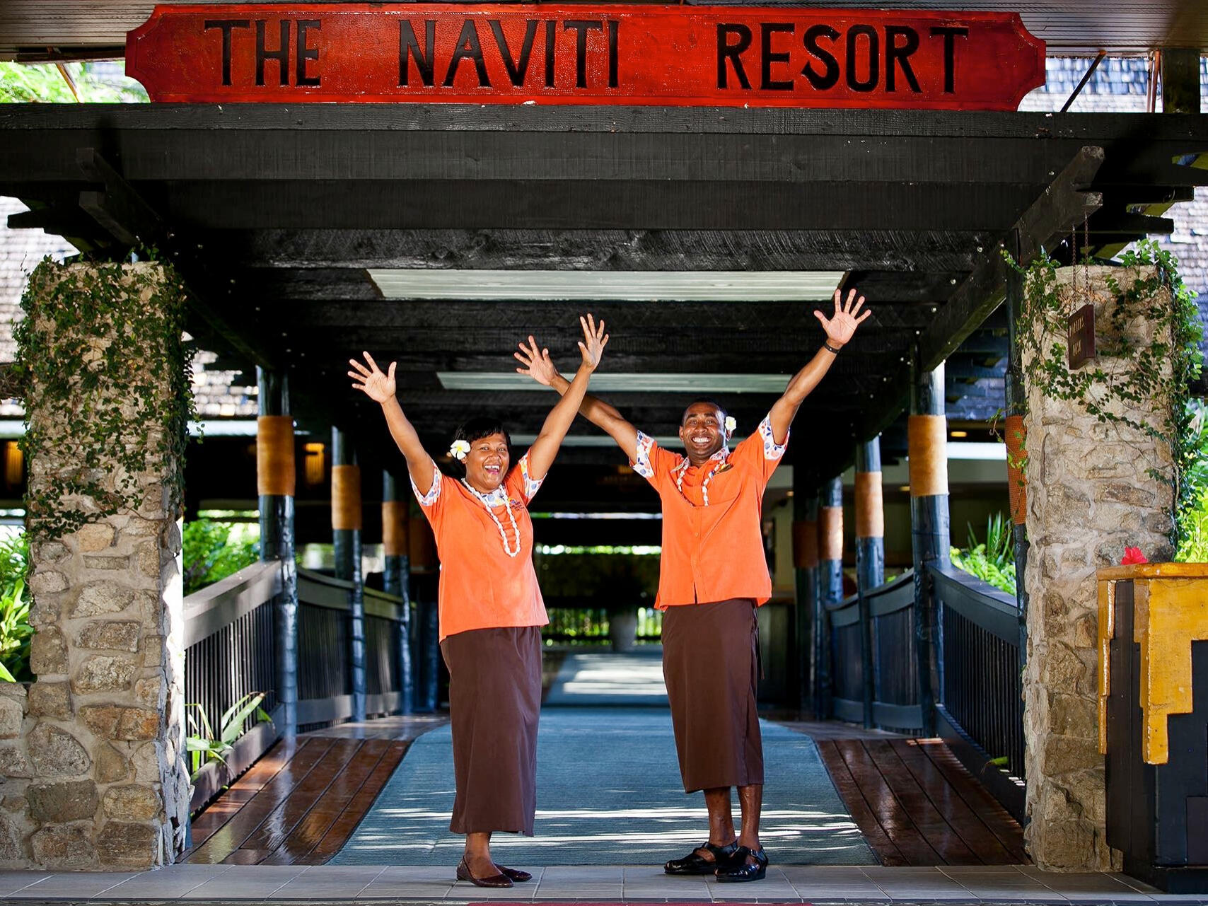 hotel workers happy at the entrance Naviti Resort Fiji