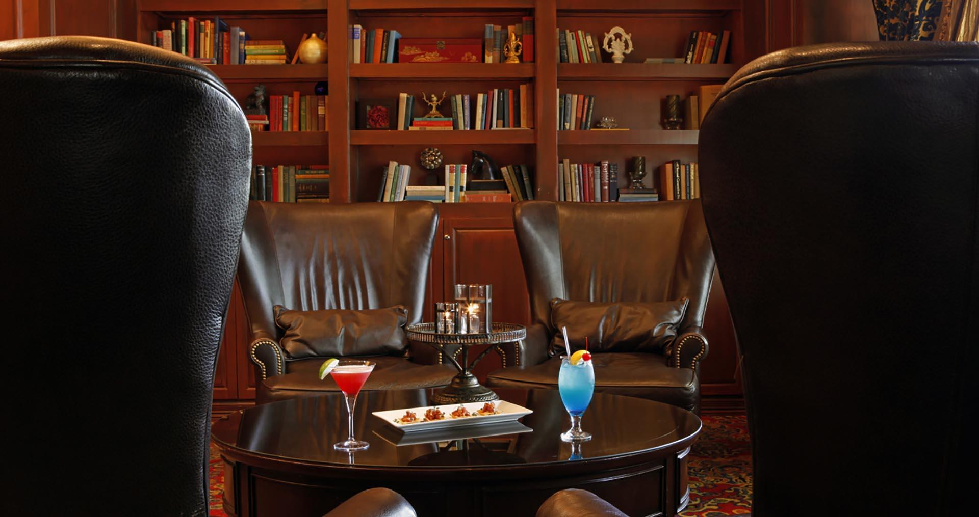 Wingback Chairs on Library Bar with Drinks