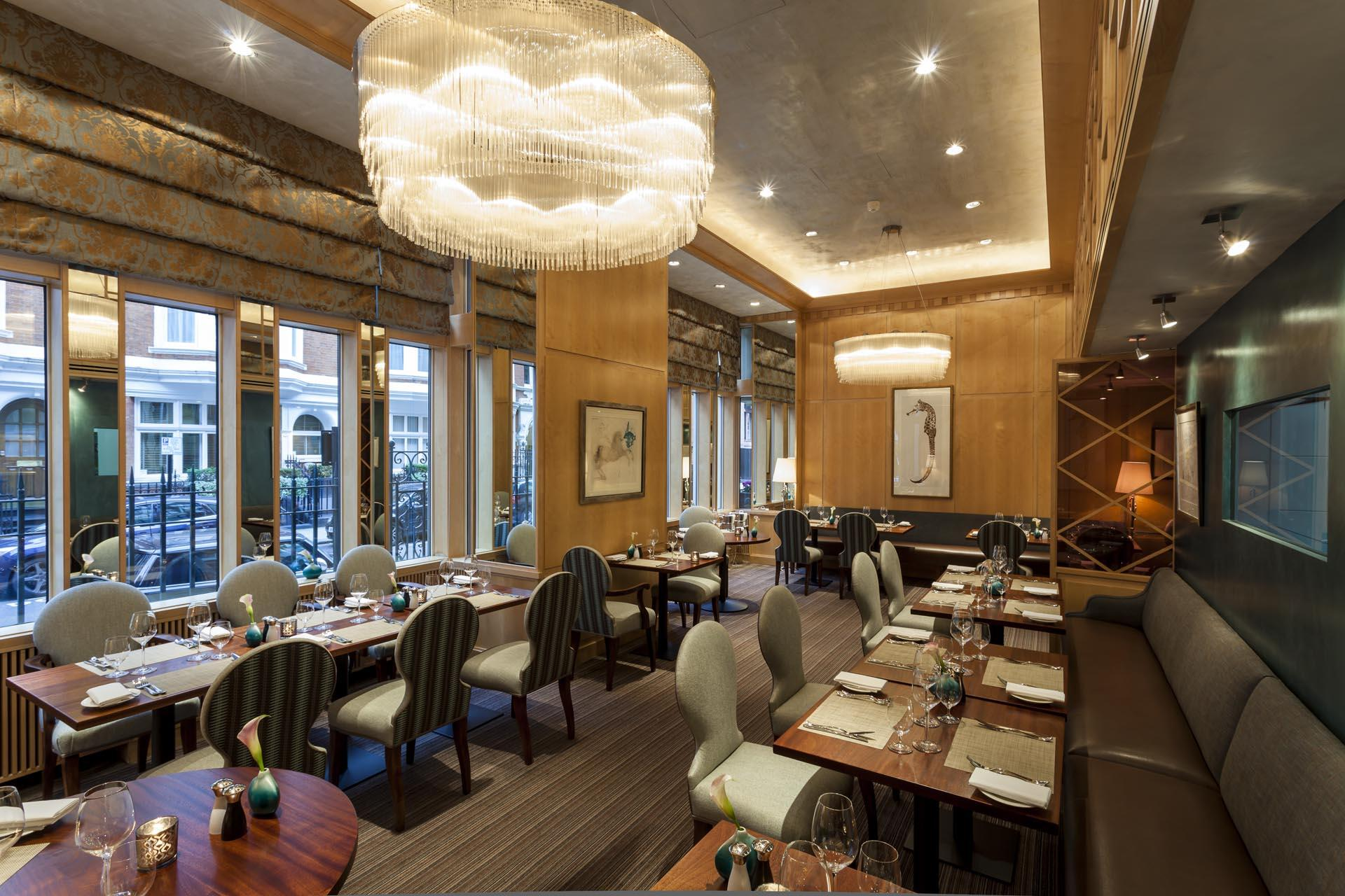 Dining area with exterior views at The Restaurant at the Capital