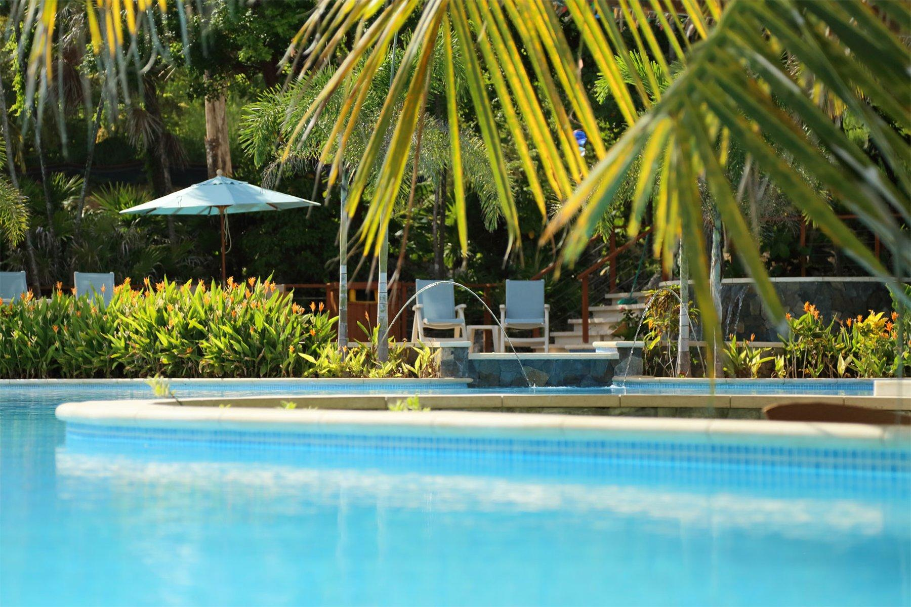 pool with lounge chairs and umbrella