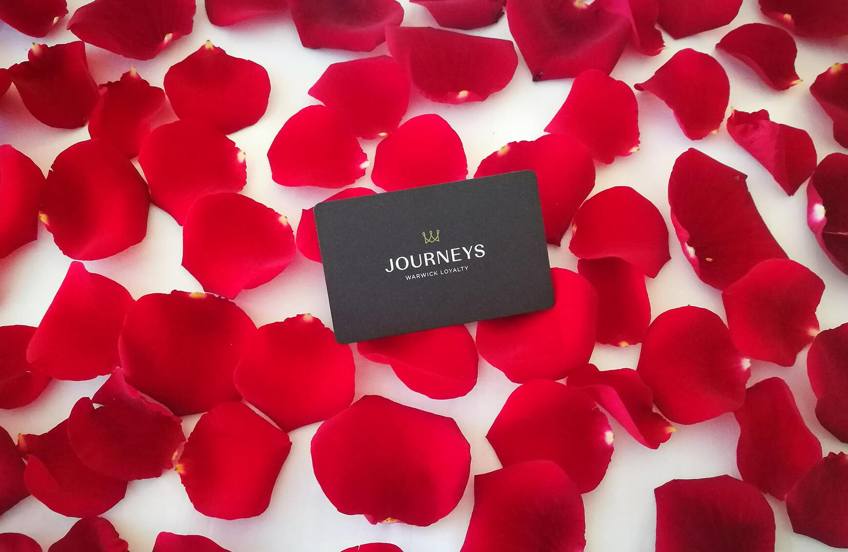 warwick journeys card on rose petals