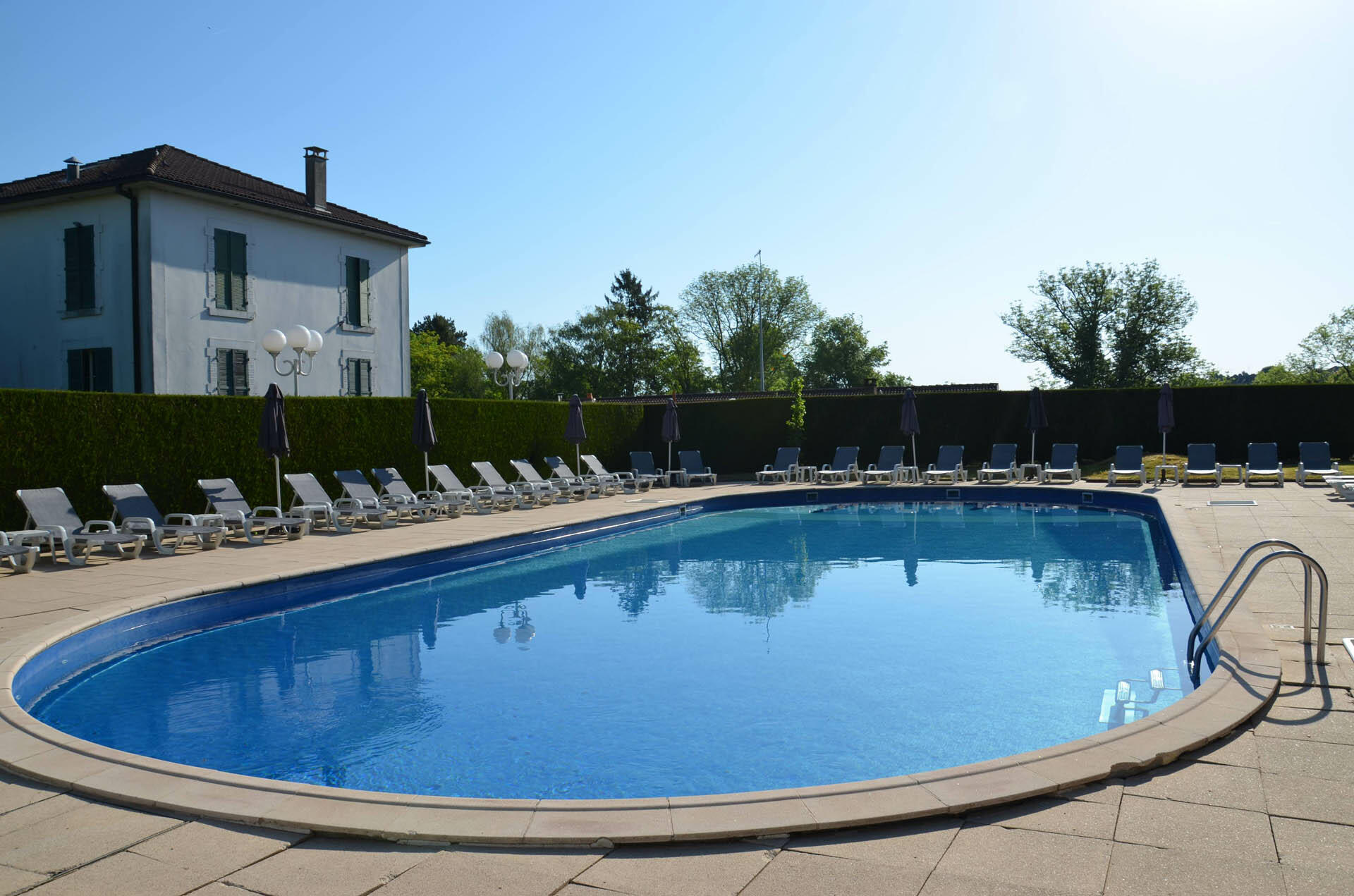 Pool at Hôtel-Club Cosmos in Contrexéville, France