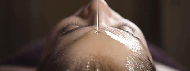 Woman having oil treatment in crown spa at Crown Hotels