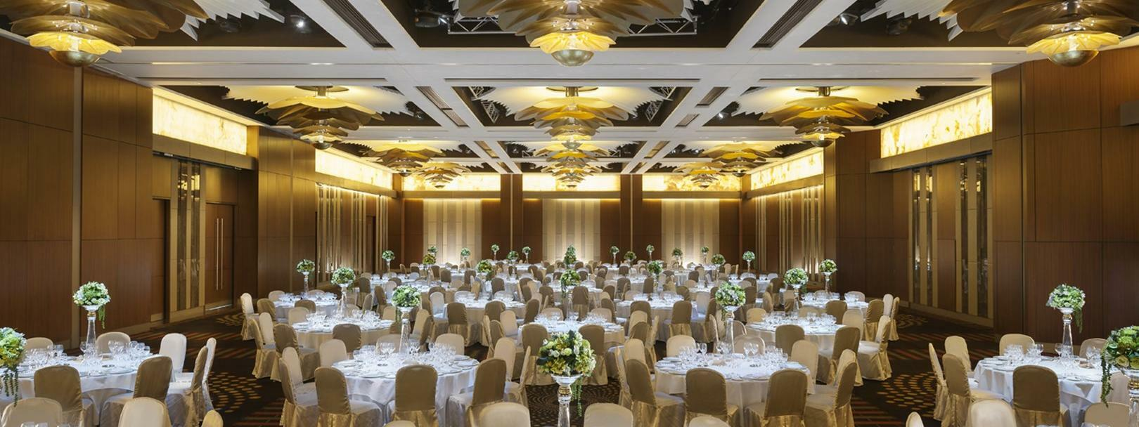 A room meeting room with decorated round tables at Crown Hotel Perth