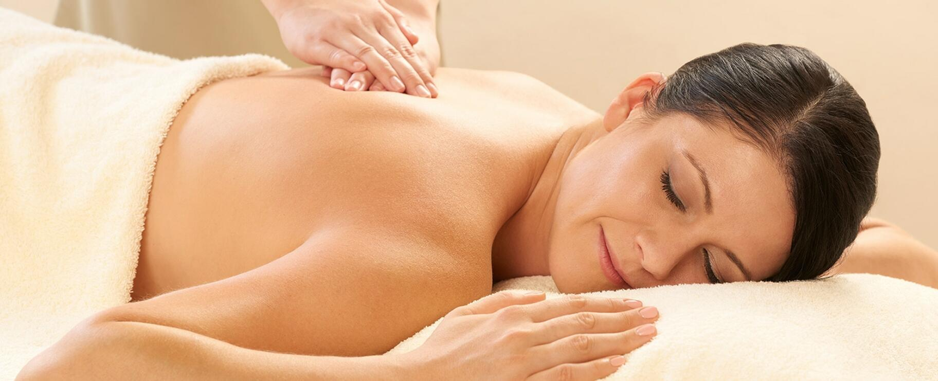 A lady receiving a massage at the Spa in the hotel