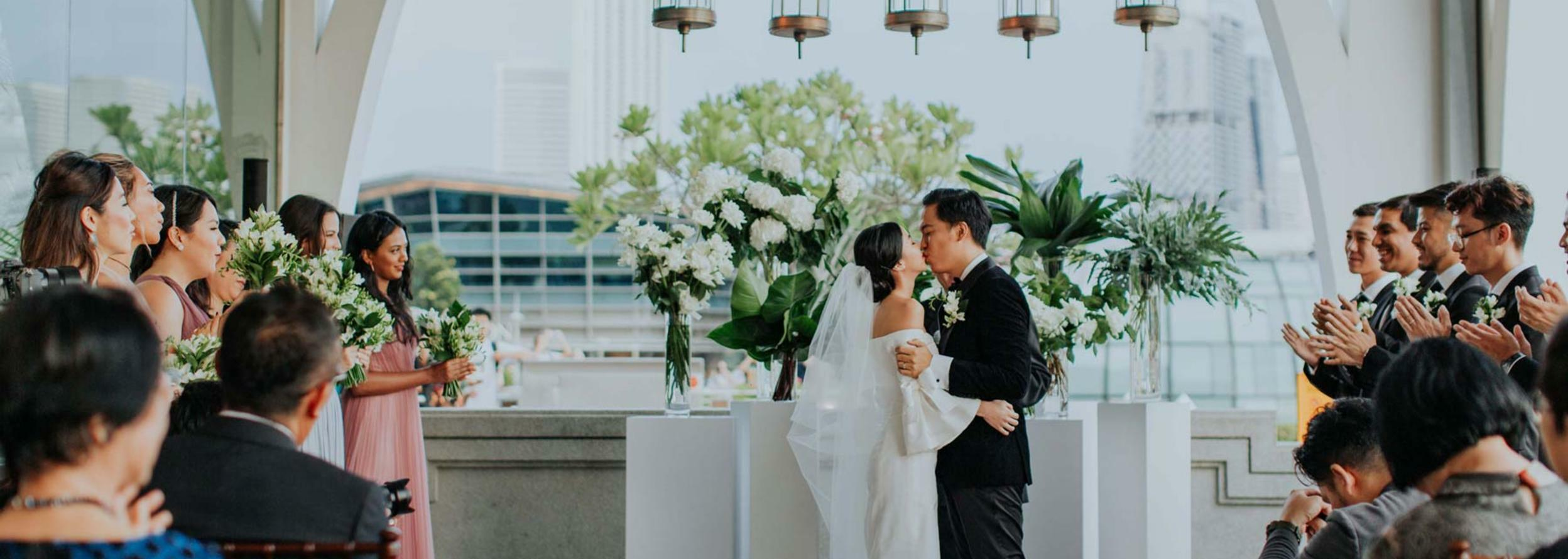 Bride and groom kissing at the wedding ceremony