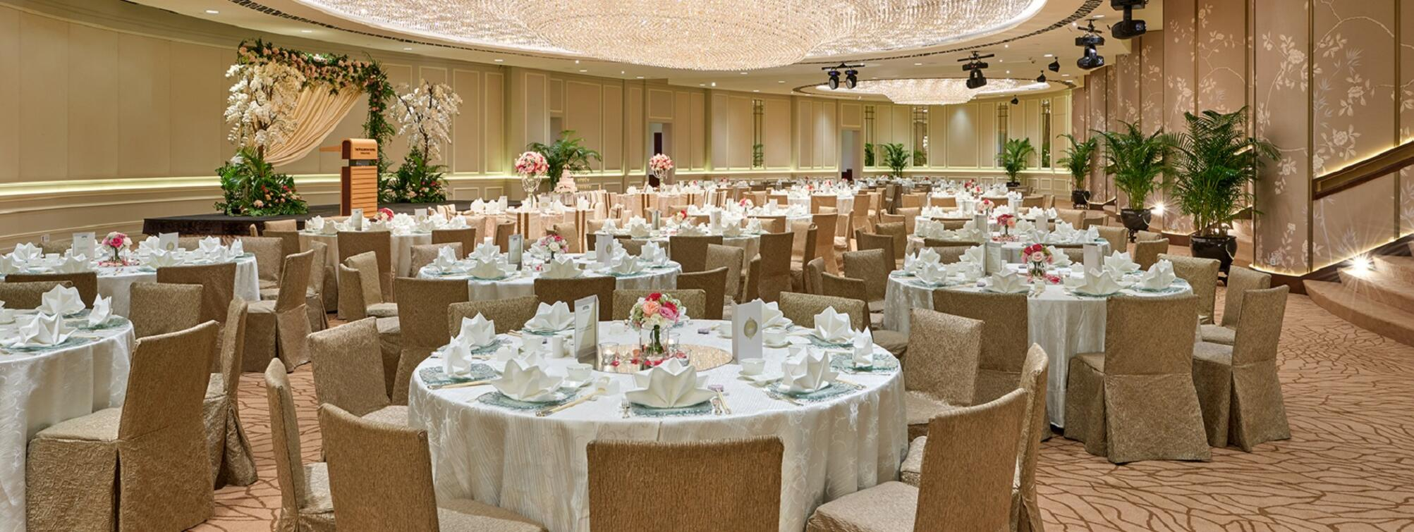 The arranged Ballroom with white tables and chairs for an event