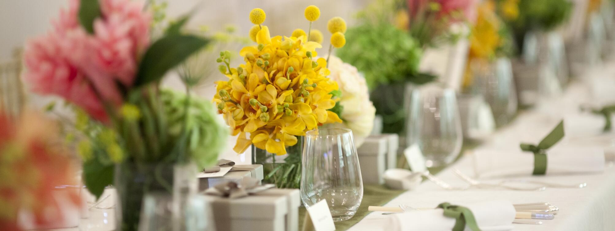 A table arranged for an event with flowers