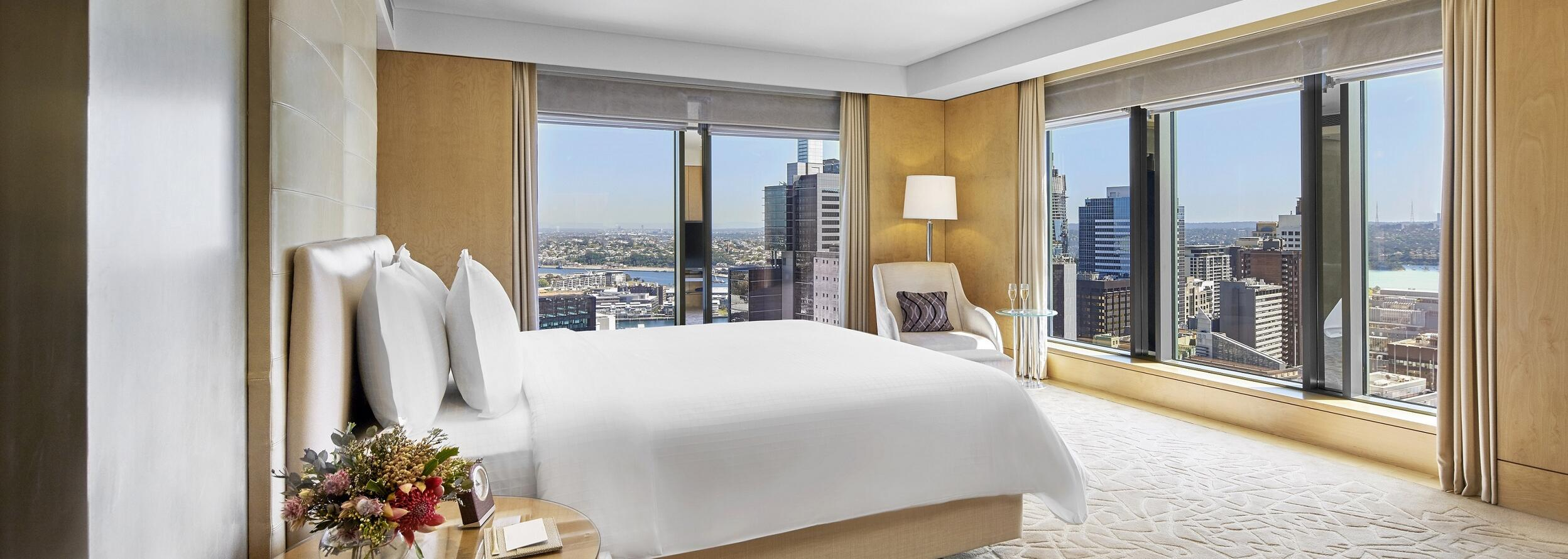 A room with one king bed and a city view