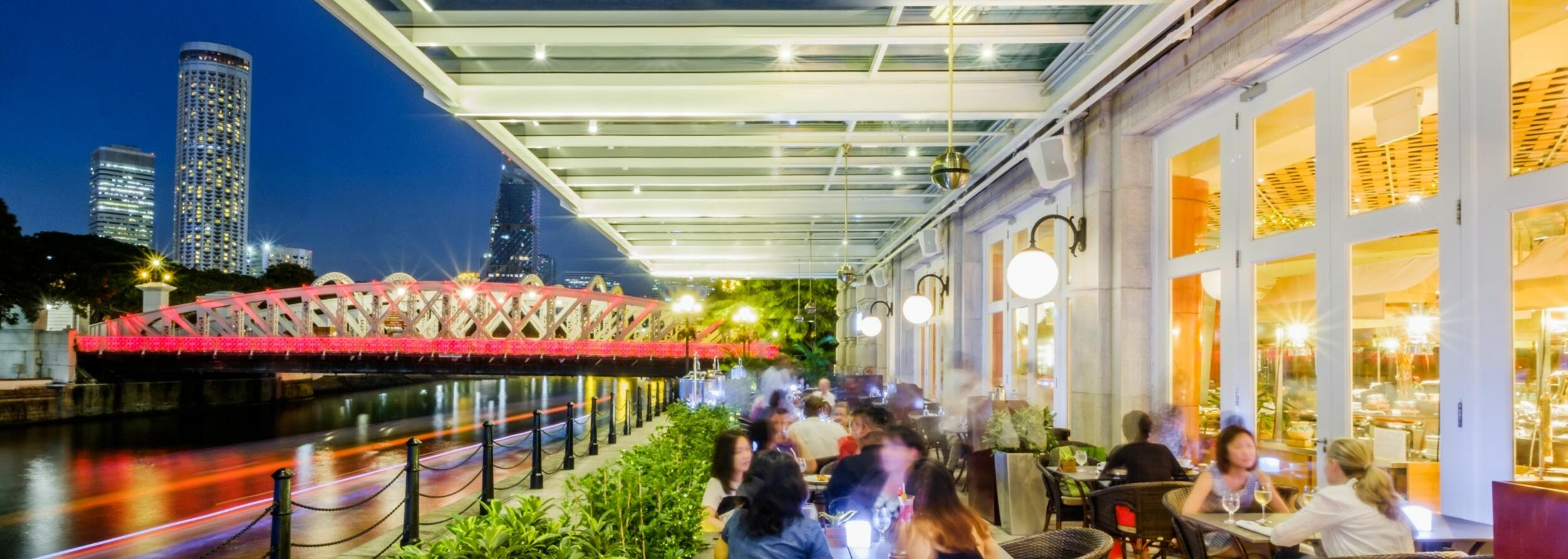 The outdoor area in the Town Restaurant with a night city view