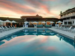 pool with lounge chairs at dusk