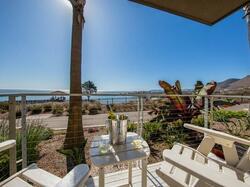 two chairs facing beautiful a beautiful beach