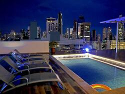 chairs facing a rooftop pool