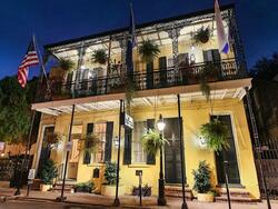 Exterior view of Andrew Jackson Hotel at night with lights