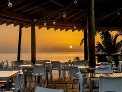outdoor restaurant patio overlooking ocean and sunset