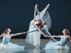 four ballet dancers perforiming on stage