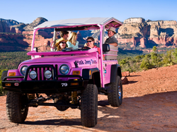 A group of people enjoying their ride in a jeep