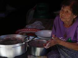 Old lady selling foods in Nong bua walking street  near Chatrium Golf Resort Soi Dao Chanthaburi