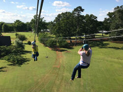 two people zip lining