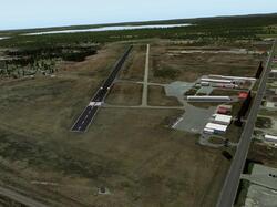 open field with landing strip