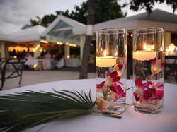 Centerpieces with floating candles and palm leaf at Tamarind Reef Resort