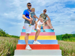 Family at Colourful Sky Ladder Pineapple Farm
